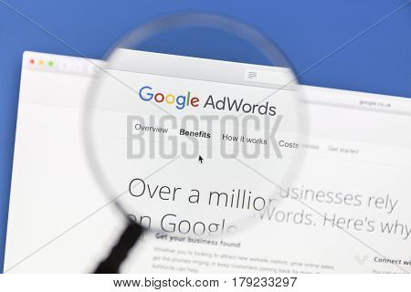 Ostersund, Sweden - Mars 29, 2016: Google Adwords website under a magnifying glass. Google AdWords is an online advertising service.