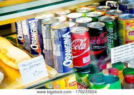 Paris France - October 08 2015: Several soft drink cans in a shop window. We can see various cans of Orangina Coca Cola classic Coca Cola Zero Coca Cola Life Lipton and Jocker