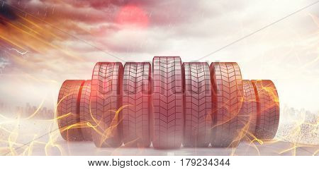 Row of tyres against open road 3d