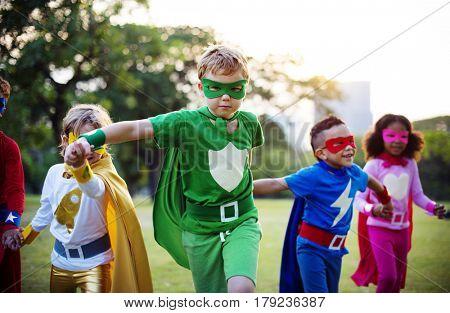 Kids Wear Superhero Costume Outdoors