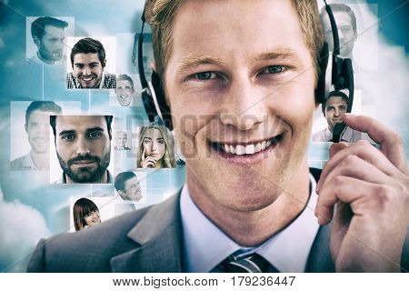 Handsome agent wearing headset against blue background