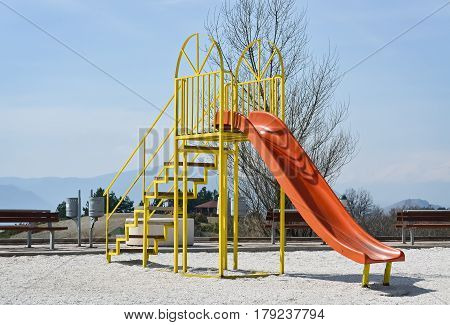 Playground and slider in the nature in a beautiful spring day