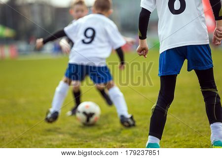 Football Soccer Background. Football Player Running with the Ball on the Pitch. Footballers Kicking Football Youth Soccer Sport Background. Match on the Pitch. Young Teen Soccer Game.
