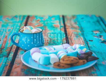 Marshmallow Cookies And Chocolate On Blue Plate