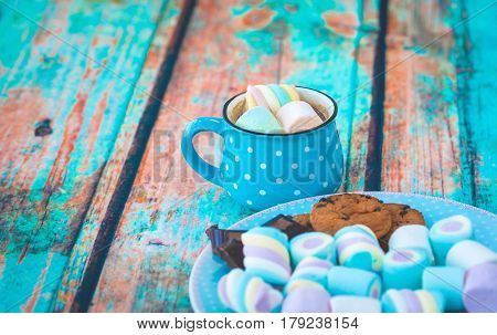 Plate And Cup Of Coffee With Marshmallow