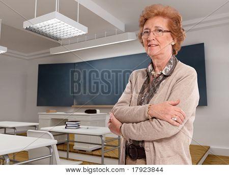 Portrait of an elegant senior lady in a classroom