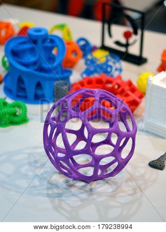 Objects printed by 3d printer. Bright colorful objects printed on a 3d printer on a table