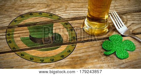 Composite image of St Patrick Day with green hat symbol against shamrocks st patrick day and fork