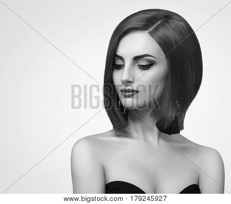 Grace and elegance. Monochrome studio portrait of a young beautiful elegant fashionable woman looking away sensually wearing black dress copyspace beauty skin perfection confidence feminine
