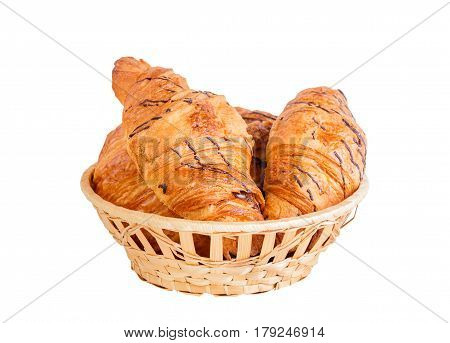 Delicious croissants in basket isolated on white background. Selective focus