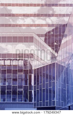 Skyscraper crystal facade with blue sky reflections. Architecture background. Empty copy space for Editor's content.