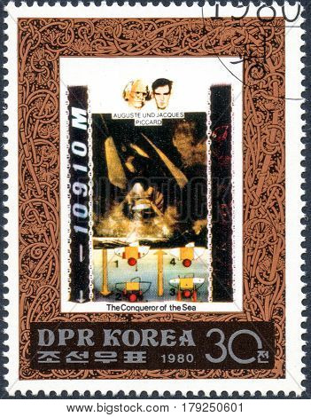 UKRAINE - CIRCA 2017: A postage stamp printed in DPR North Korea shows Auguste and Jacques Piccard serie The Conqueror of the Sea circa 1980