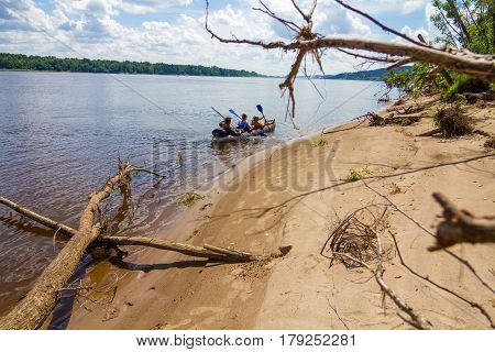 Canoe along the shore. Canoeing on the river.