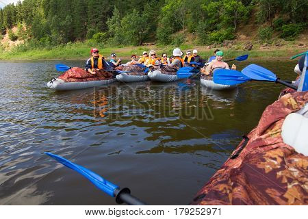 Canoeing on the Kama river, Doksha district, Russia - 07.06.2014: Editorial.  The group discusses further actions.