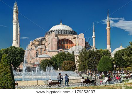 ISTANBUL, TURKEY - MAY 24, 2013: Tourists visiting the Hagia Sophia. Hagia Sophia is the greatest monument of Byzantine Culture.