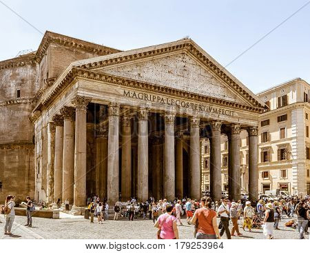 ROME, ITALY - MAY 9, 2014: Tourists visit the Pantheon on the Piazza della Rotonda. Pantheon is a famous monument of ancient Roman culture built in the 2nd century.