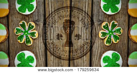 Composite image of St Patrick Day with beer glass symbol against shamrocks st patrick day