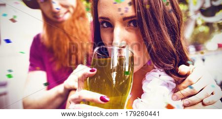 Flying colours against portrait of woman holding green pint 3d