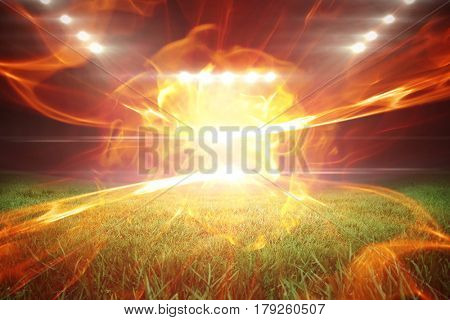 Ball of fire against football pitch with bright lights 3d