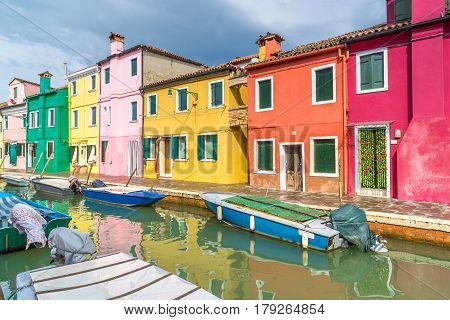 Colorful houses on Burano. A typical street and canal on the island of Burano near Venice.