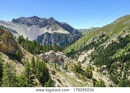 View over the mountains of the French Alps in the summer at the Pass Col d'Izoard