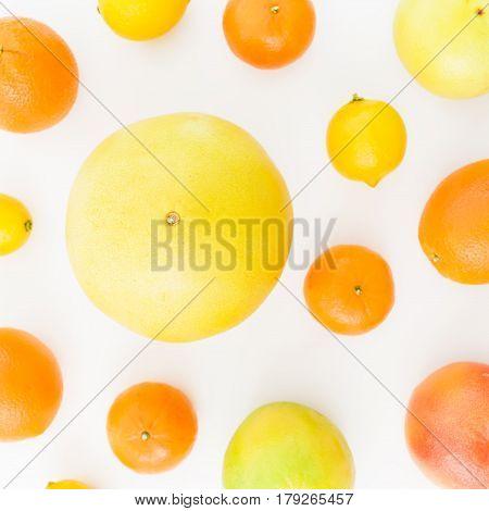 Fruit pattern. Lemon, orange, mandarin, grapefruit and sweetie on white background. Flat lay, top view.