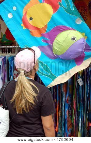 Teen Shopping For A Flag