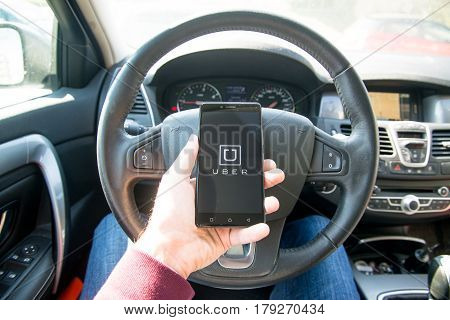 Paris, France, march 31, 2017: Driver starting uber application