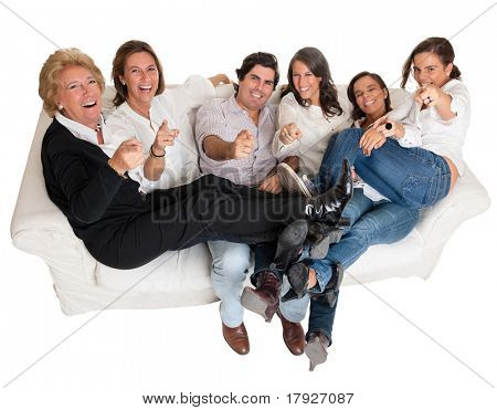 Isolated family group pointing at the camera happily laughing