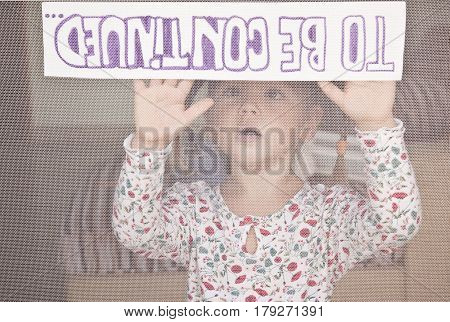 child holds a sign