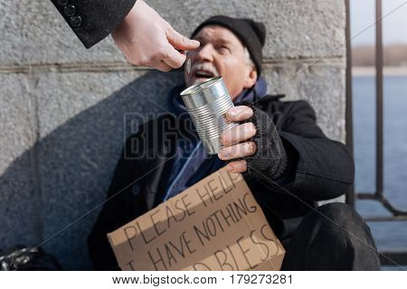 You are kind man. Needy old male person opening his mouth while looking upwards leaning on the column