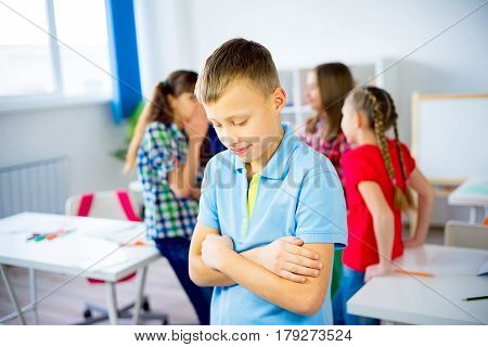 Students are byllying a boy at school