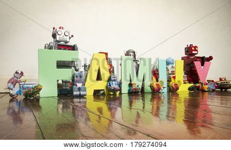 The word    FAMILY on wooden floor with reto robots