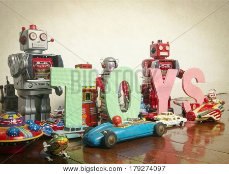 the word   TOYS on wooden floor with reto robots