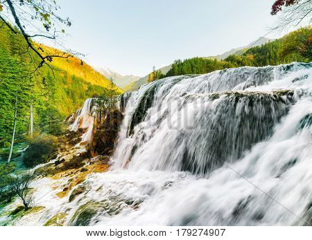 Wonderful View Of The Pearl Shoals Waterfall Among Mountains