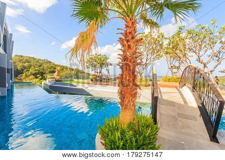 PHUKET, THAILAND - JANUARY 22, 2017: Scenery of swimming pool at Crest Resort and Pool Villas and Resorts is the latest luxury intimate gems an eco friendly resort Phuket island in Thailand.