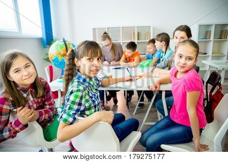 Students work together on a lesson at school