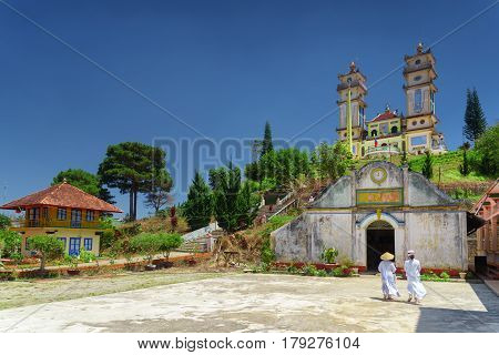 Towers of the Thanh That Da Phuoc on blue sky background. Scenic view of the temple for the Cao Dai religion adherents at Dalat (Da Lat) Vietnam. Dalat is a popular tourist destination of Asia.
