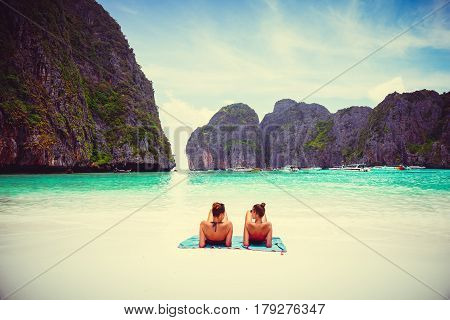Female tourist laying at Phi Phi Maya Bay in the summer of Krabi Thailand