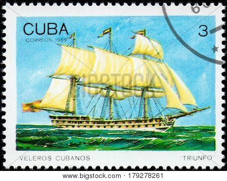 UKRAINE - CIRCA 2017: A postage stamp printed in Cuba shows sailing ship Triunfo Triumph from the series Cuban sailboats circa 1989
