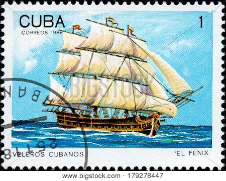 UKRAINE - CIRCA 2017: A postage stamp printed in Cuba shows sailing ship El Fenix from the series Cuban sailboats circa 1989