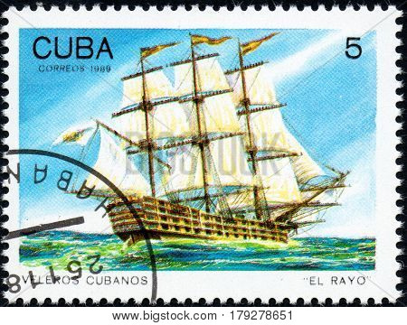 UKRAINE - CIRCA 2017: A postage stamp printed in Cuba shows sailing ship El Rayo from the series Cuban sailboats circa 1989