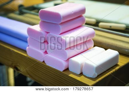 Soap production in shop. Pink white and violet soap.Selective focus.