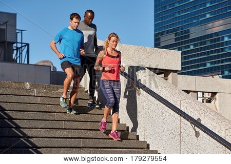 Multi ethnic racial people running between modern office buildings, healthy lifestyle work life balance