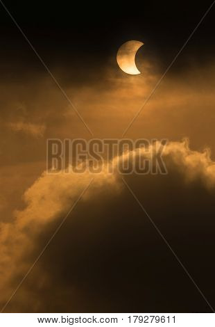 The Moon Covering The Sun In A Partial Eclipse With Dramatic Cloud. Scientific Background, Astronomi