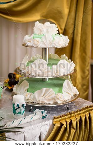 Delicious and beautiful wedding cake. Completed in three tiers and originally decorated