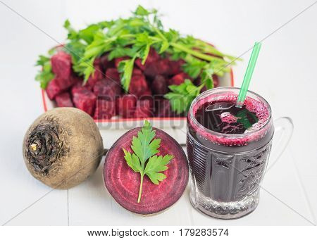 Sliced Red Beets And Beet Juice On White Wooden Table.
