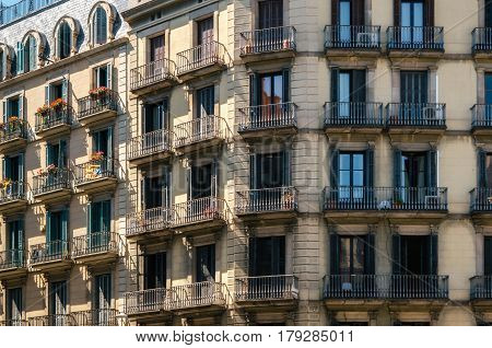 Geometric shapes of facade of modernist residential building with french balconies in Barcelona Spain.
