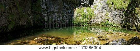 Izbucul Tauzului, karst spring in Apuseni mountains, Romania