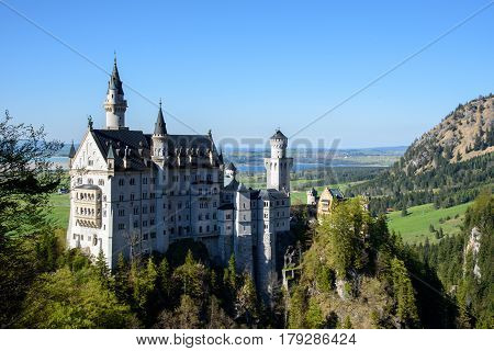 Beautiful view of world-famous Neuschwanstein Castle, the 19th century Romanesque Revival palace built for King Ludwig II, in beautiful evening light at sunset, Fussen, southwest Bavaria, Germany.